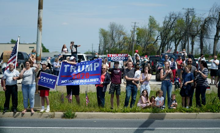 People watch as a motorcade with President Donald Trump drives past on Thursday, May 14, in Allentown, Pennsylvania.