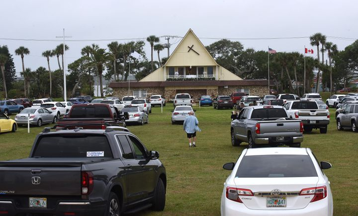 People in cars attend services at a Daytona Beach church on Easter Sunday.