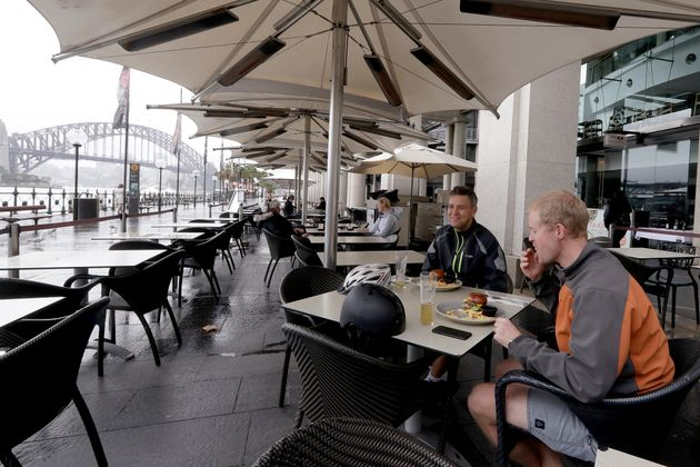 Rob Barton, right, and Charlie Downe have lunch at a restaurant along the shoreline as stage 1 of the...