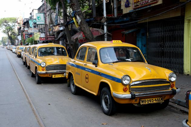 Yellow Ambassador Taxi are parked on a roadside on the first day of the government-imposed nationwide...