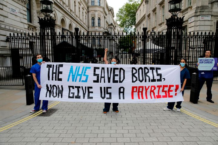 Nurses who work at central London hospitals protest outside Downing Street in on May 13, 2020 calling for improved conditions