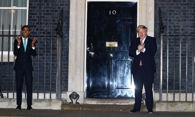Prime Minister Boris Johnson and Chancellor Rishi Sunak clapoutside 10 Downing Street in support...