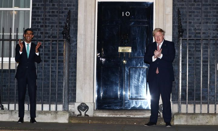 Prime Minister Boris Johnson and Chancellor Rishi Sunak clapoutside 10 Downing Street in support of NHS workers, March