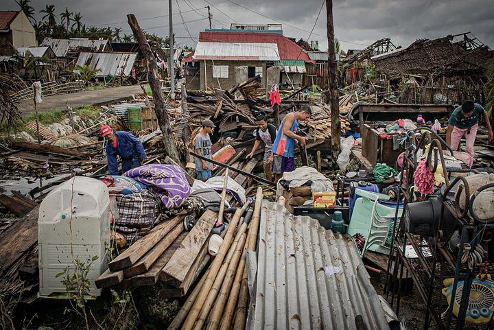 Residents try to salvage belongings amongst their houses destroyed at the height of Typhoon Vongfong in San Policarpo town, E