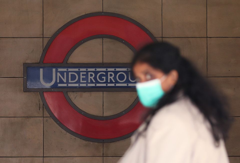 A commuter wearing a face mask at Leicester Square London Underground station, after the announcement...