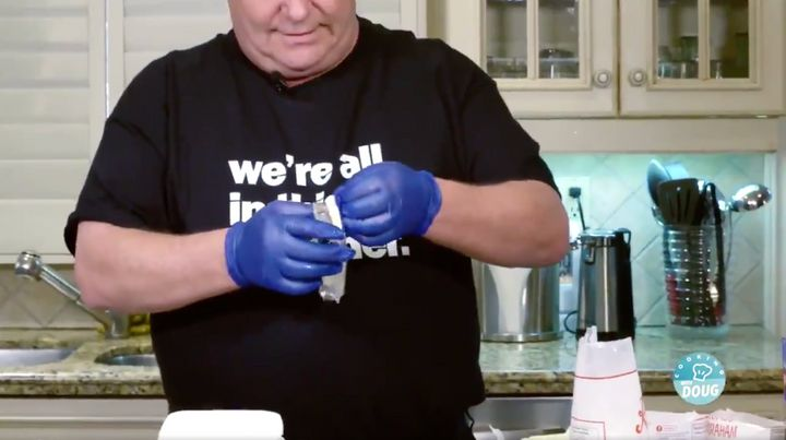 Why is Doug Ford wearing gloves to make cheesecake?