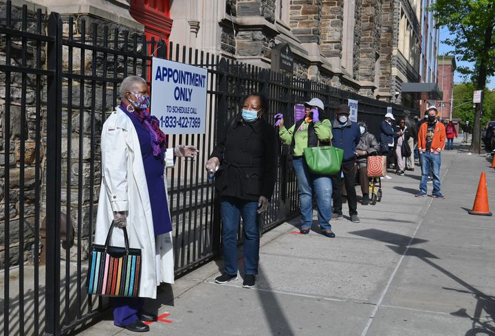 Residents wait in line Thursday to get tested for COVID-19 antibodies at Abyssinian Baptist Church in the Harlem neighborhood