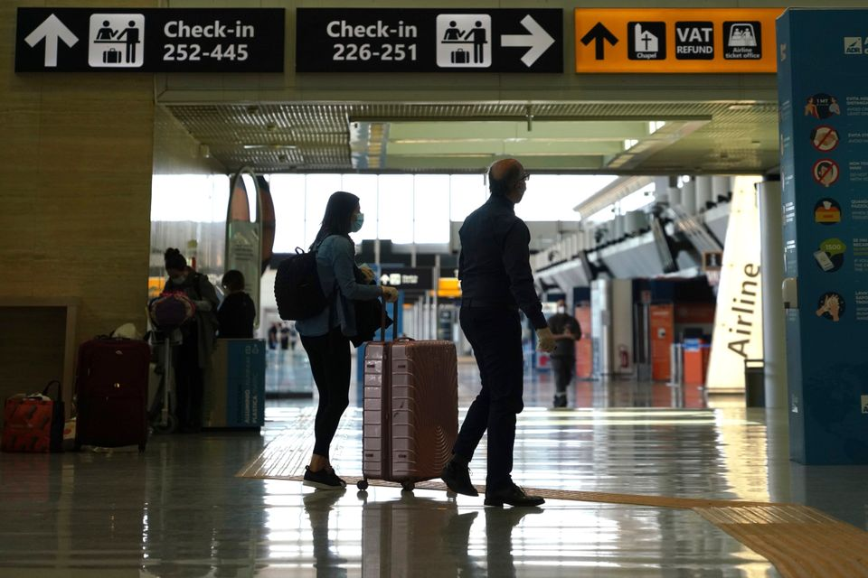 Passengers walk through Rome's Leonardo da Vinci international airport in