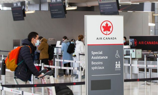 Travellers check in at the Air Canada counters of Pearson International Airport in Toronto, April 27,...