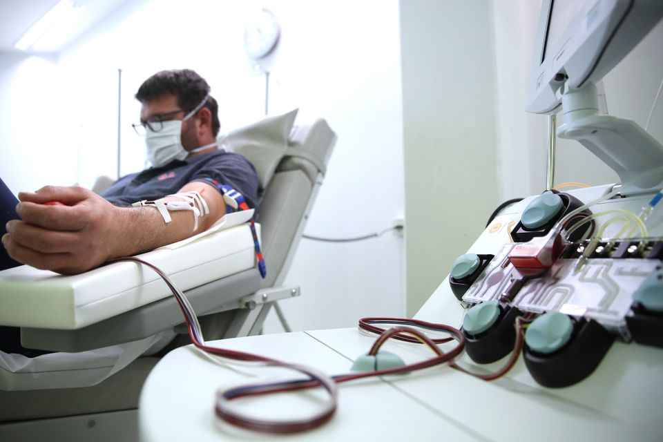 ERLANGEN, GERMANY - APRIL 27: A recovered Covid-19 patient donates blood plasma for research into Covid-19...