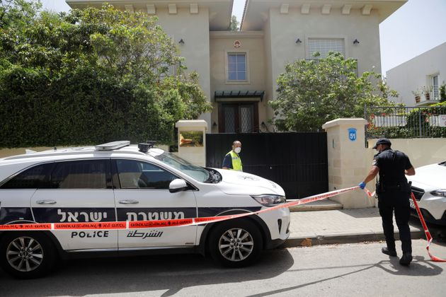 An Israeli policeman cordons off an area near the house of China's ambassador to Israel, Du Wei, in Herzliya,...