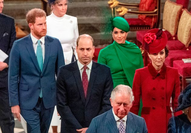 Britain's Prince Harry, Duke of Sussex (L) and Britain's Meghan, Duchess of Sussex (2nd R) follow Britain's...