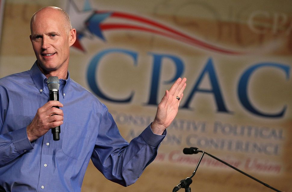 Sweeping cuts to Florida's unemployment system under Rick Scott, the former Republican governor, help explain why the state h