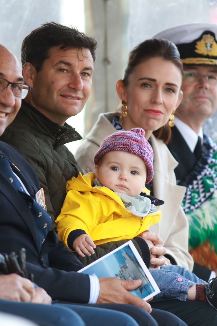 Prime Minister Jacinda Ardern (R) her partner Clarke Gayford (L) and their child Neve pictured in 2019.