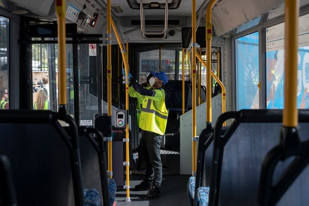 Cleaners are pictured at work while wearing PPE at the Waverley Bus Depot on April 29, 2020 in Sydney,