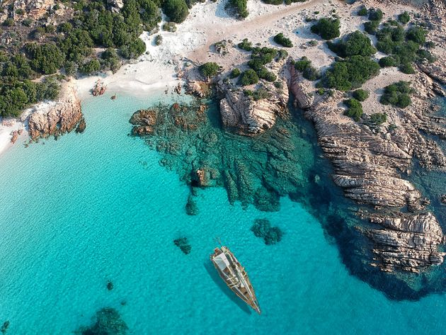 Aerial view of Sailboat on emerald sea at Sardinia