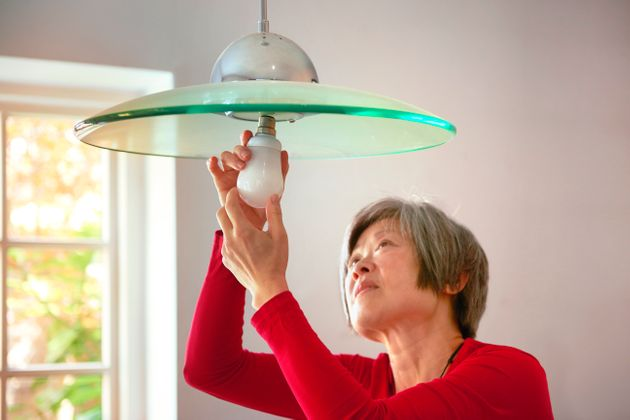 woman concentrating changing her energy efficient