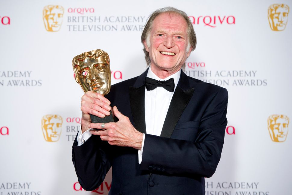 David Bradley, seen here winning Best Supporting Actor at the TV Baftas for Broadchurch, has filmed new acting work from home
