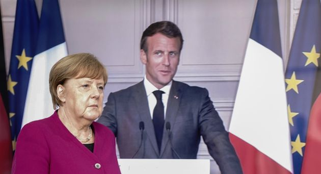 German Chancellor Angela Merkel arrives to address a joint press conference with French President Emmanuel...