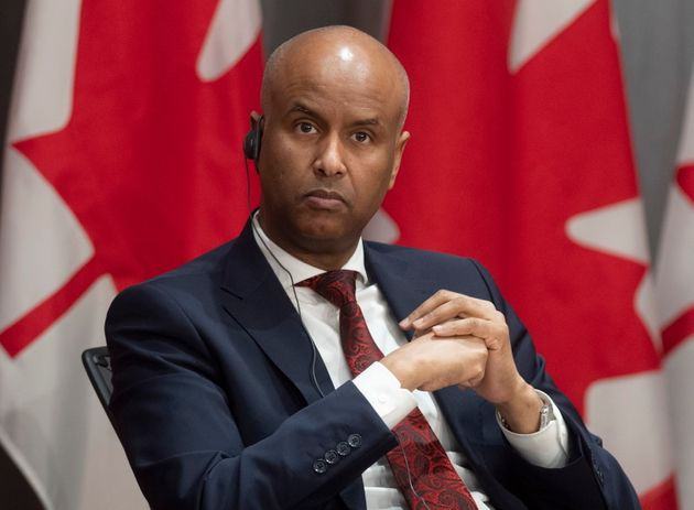 Families, Children and Social Development Minister Ahmed Hussen listens to a question during a news conference...