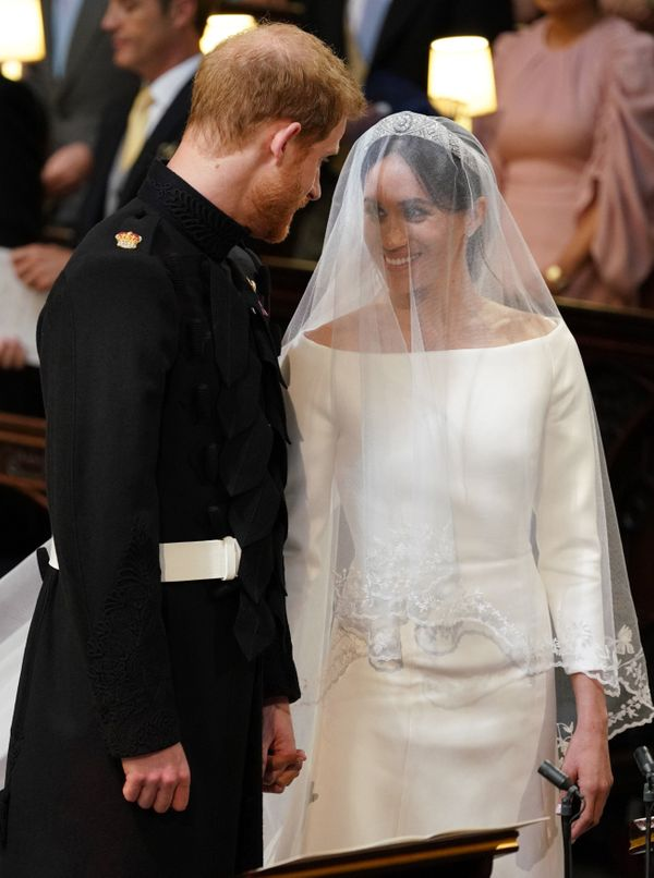 Harry and Meghan stand together during their nuptials.
