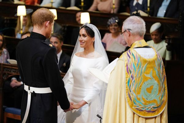 The couple holding hands during their wedding service, conducted by the Archbishop of Canterbury Justin Welby.