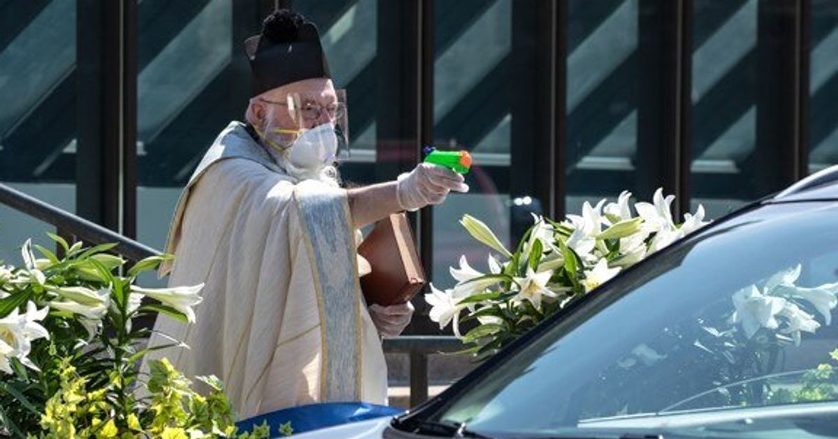 Priest Goes Viral After Using Squirt Gun Full Of Holy Water To Bless People