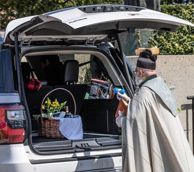 Priest Goes Viral After Using Squirt Gun Full Of Holy Water To Bless