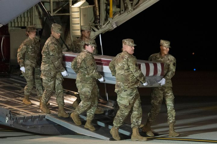 An Air Force carry team moves a transfer case containing the remains of Navy Ensign Joshua Watson on Sunday, Dec. 8, 2019, at