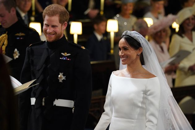 Harry and Meghan arrive at the High Altar for their wedding ceremony at St. George's Chapel, Windsor...