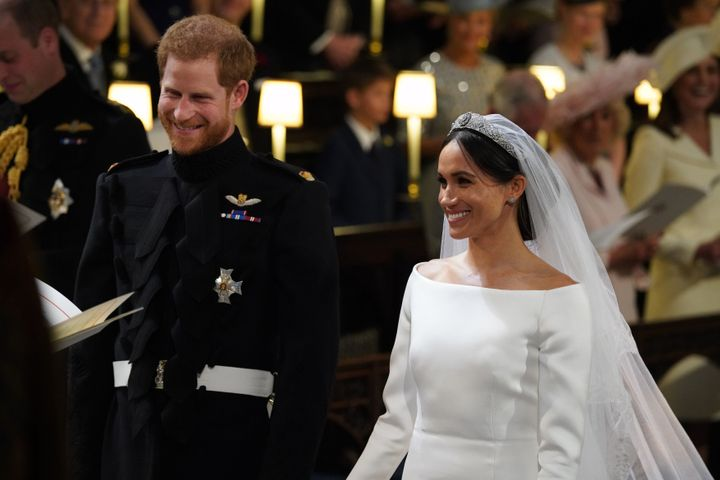 Harry and Meghan arrive at the High Altar for their wedding ceremony at St. George's Chapel, Windsor Castle, on May 19, 2018.