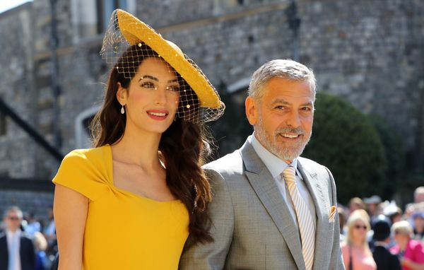 Amal Clooney and George Clooney arrive.