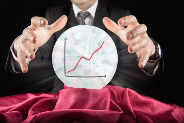 Fortune teller businessman, sees rising graph in a crystal