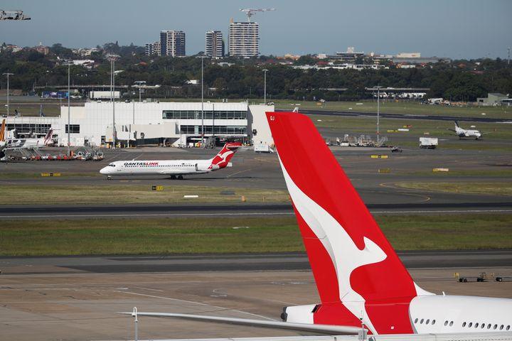Qantas planes are seen at Kingsford Smith International Airport. REUTERS/Loren Elliott/File Photo