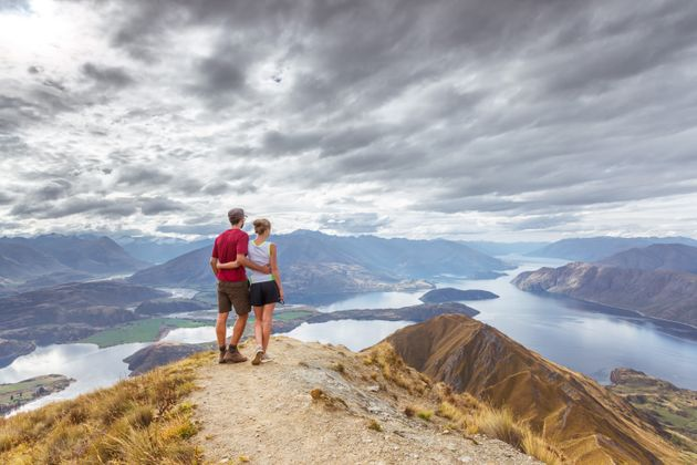 Tourist couple looking at view, Mt Roy, Wanaka, New