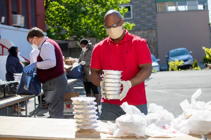 Jamaal Bowman distributes food at a food bank in Yonkers, New York. His presence in the district has helped win him the backi