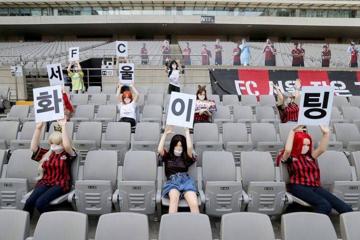 Cheering mannequins are installed at the empty spectators' seats before the start of soccer match between FC Seoul and Gwangj