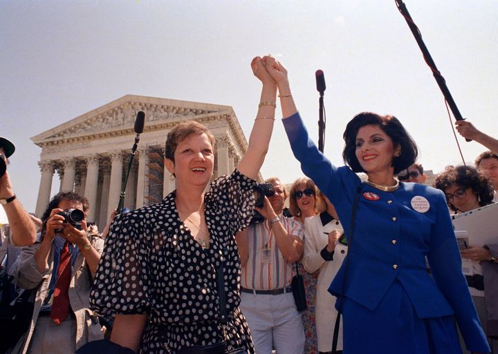 In this April 26, 1989, file photo, Norma McCorvey, Jane Roe in the 1973 court case, left, and her attorney Gloria Allred hol