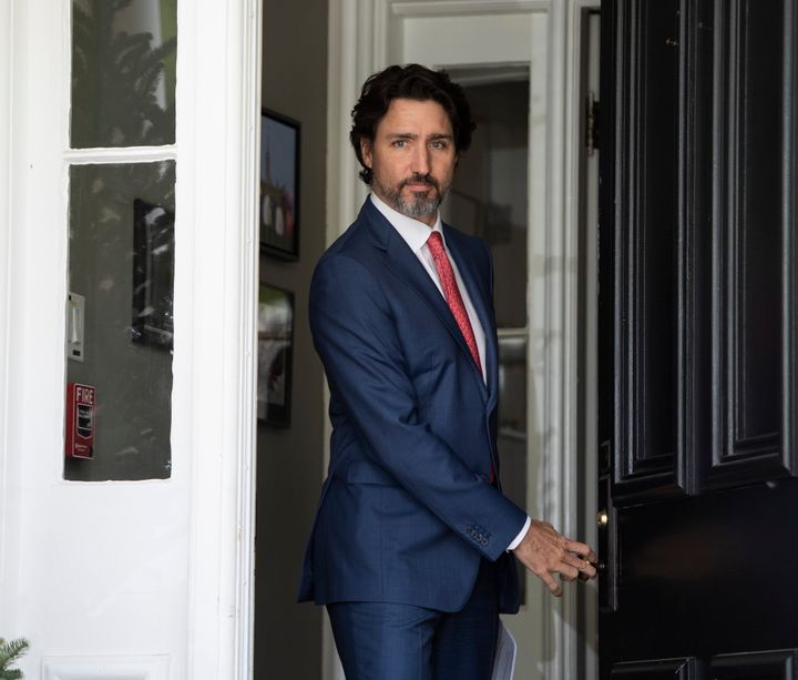 Prime Minister Justin Trudeau arrives for his daily news conference on the COVID-19 pandemic outside his residence at Rideau Cottage in Ottawa, on May 19, 2020.