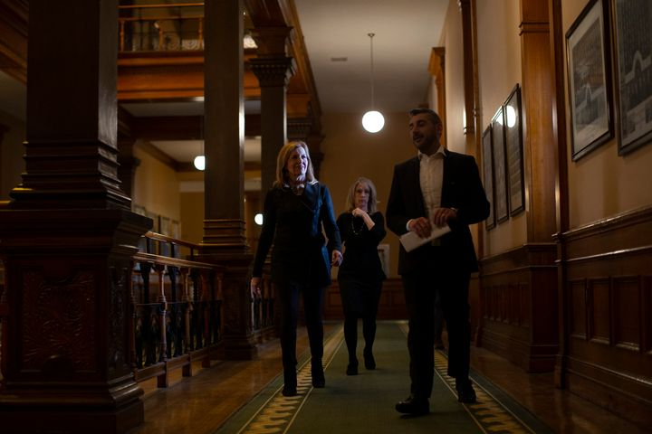 Ontario's Minister of Health Christine Elliott, left, walks with Ross Romano, Minister of Colleges and Universities and Merrilee Fullerton, Minister of Long Term Care, at Queen's Park in Toronto on April 18, 2020.