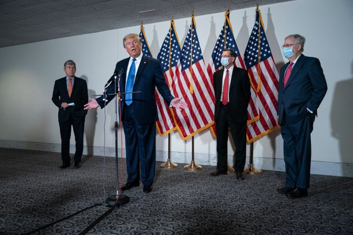 President Trump speaks to the press after a policy meeting with Republican senators Tuesday.
