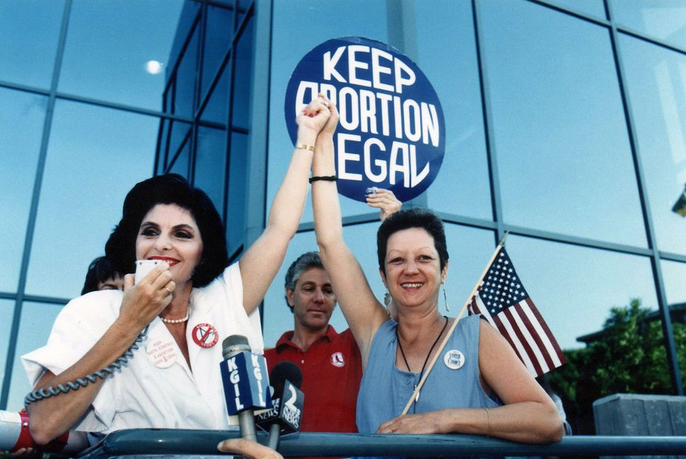 Attorney Gloria Allred and Norma McCorvey at a pro-choice rally in California in July 1989.
