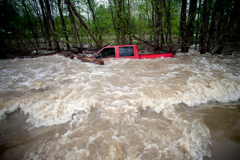 Tittabawassee Fire and Rescue rescued the driver from this red pickup truck on Tuesday in Saginaw County, Mich. The truck was