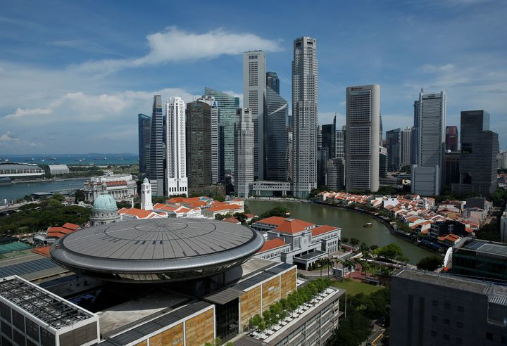 A view of the Supreme Court building in the backdrop of the skyline of Singapore's central business district.