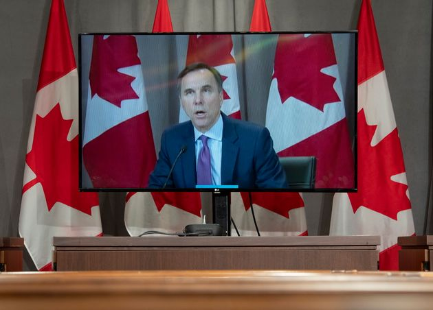 Finance Minister Bill Morneau is displayed on a television as he participates in a daily briefing by...