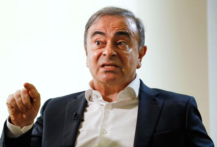 Former Nissan Chairman Carlos Ghosn speaks to Japanese media during an interview in Beirut, Lebanon, Friday, Jan. 10, 2020.