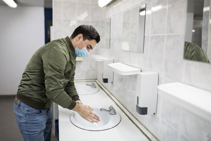 Wash your hands thoroughly when using a public restroom. Don't forget your mask, either.