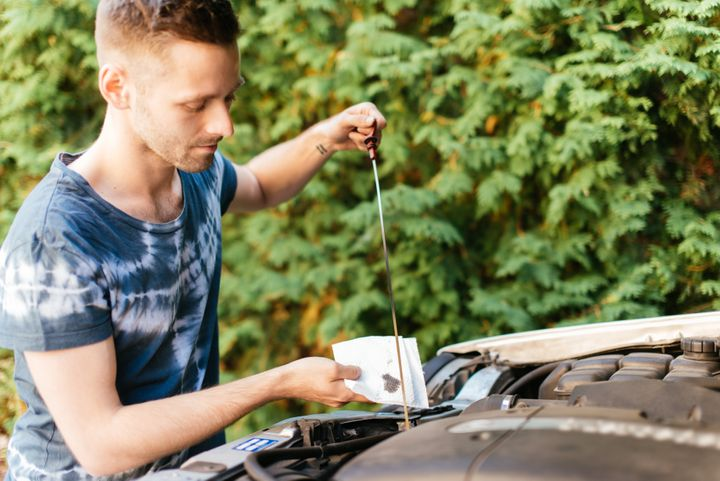 It's not a bad idea to check your car's oil status before heading out.