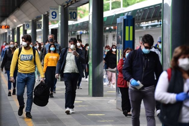 Commuters arrive from a regional train on May 4, 2020 at the Cardona railway station in Milan, as Italy...