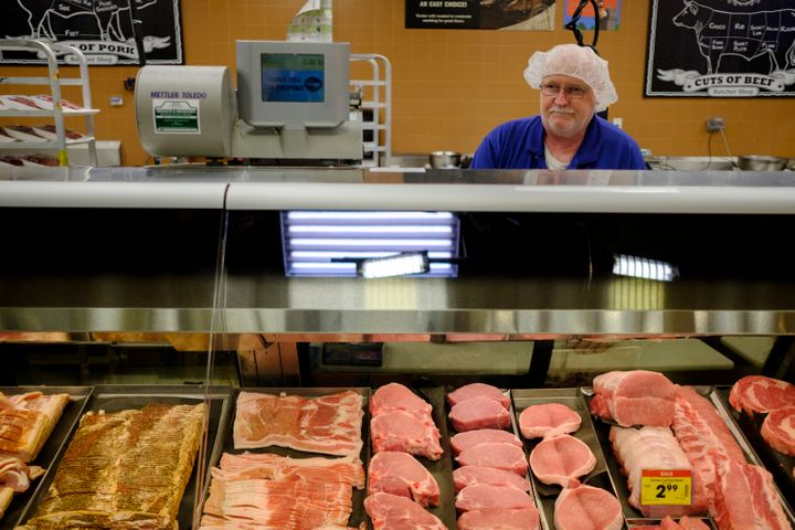 A worker manning the meat department at a Kroger in Bloomington, Indiana.
